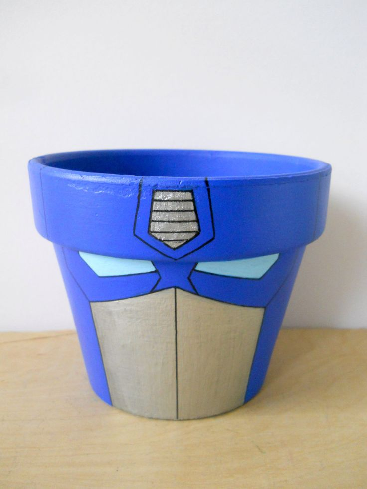 Transformers Optimus Prime painted flower pot. $24.00, via Etsy.