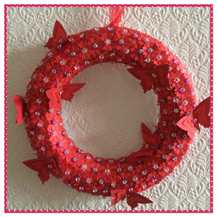 Valentine's handmade diamanté wreath, made using hand cutout flowers. Pinned with corsage diamanté pins. Contrasting card butterflies, red ribbon for hanging.