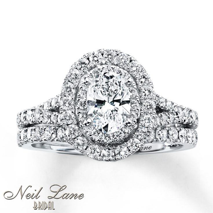 Kay Jewelers: Neil Lane Bridal® collection. Additional round diamonds grace the band of the engagement ring and the matching wedding band to complete the look. The 14K white gold bridal set has a total diamond weight of 1 1/2 carats. The Neil Lane signature appears on the inside of each band. Diamond Total Carat Weight may range from 1.45 - 1.57 carats. Diamond Total Carat We...