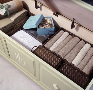 Put baskets on the shelves of your linen closet and place towels in them for a sleek, organized look!