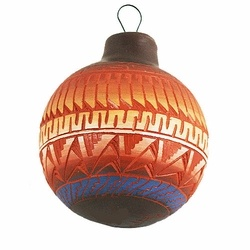 """Navajo Etchware Ornament - Etchware is a relatively new form of Navajo pottery. Each piece starts with a raw clay casting which is then painted and hand cut into intricate geometric patterns by the artist. Each ornament is one-of-a-kind - please allow for variations in color and design  Includes a card with the name and photo of the Navajo artist  Signed by the artist  Measures approx. 3"""" (7.6 cm) in diameter  Shipping weight: 1 lb. (0.45 Kg)"""