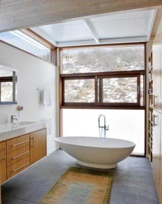Multiple windows, built-in storage, polished concrete floors and a translucent panel make this bathroom bright, neat and private.