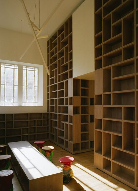 Bookshelves made of stacked modular elements at Elsa Morante Library in Lonate Ceppino, Italy (by DAP Studio)