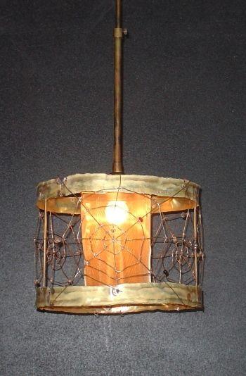 Handmade pendant lamp made by bronze, brass net and handmade glass beads.