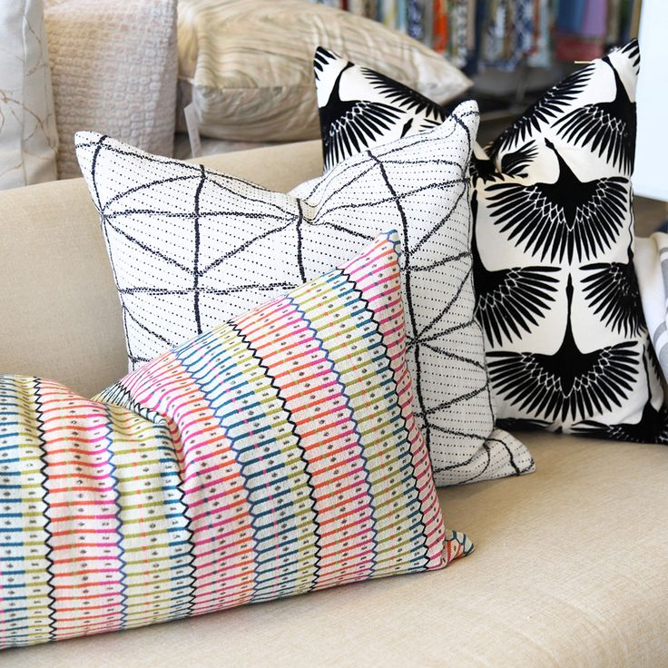 """A graphic black and cream pillow with a modern-tribal feel. Made in Canada in 20"""" x 20""""."""