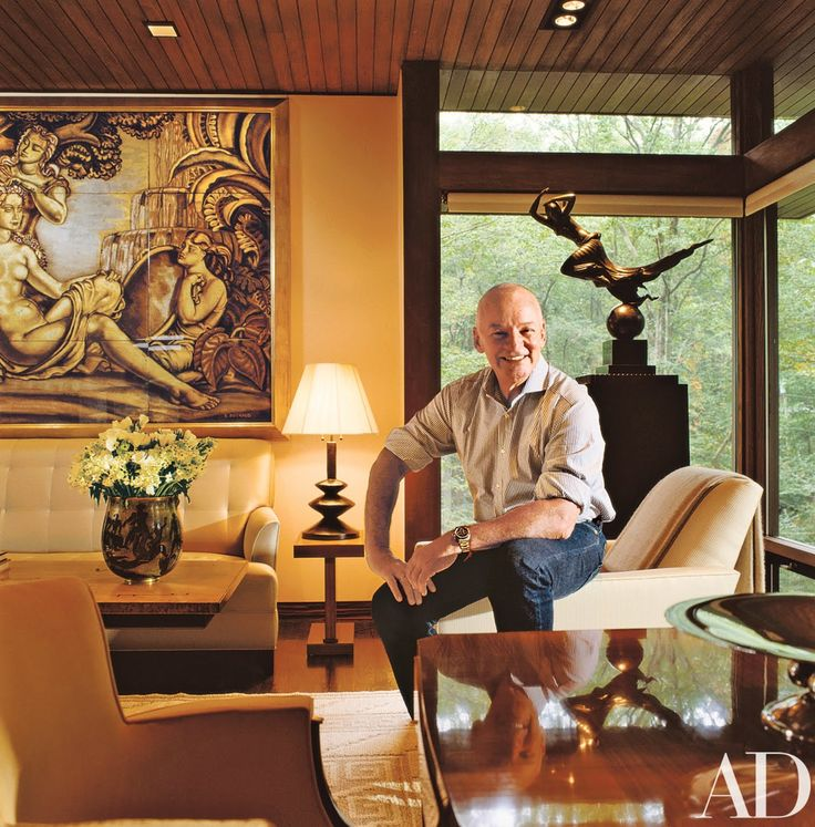 """We had all these disparate elements and did not know what to do with them: the Modern house, the Art Déco collection, the view,"" says Kay Davis, who, with husband Clyde, hired designer Juan Montoya to create the interiors for her home in Pound Ridge, New York. Montoya in the living area. The rug, by Märta Måås-Fjetterstrm, is from FJ Hakimian. Donghia club chair, right, with Scalamandré fabric. Sofa fabric, Jim Thompson."