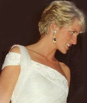 DianaOne shoulder white sari inspired chiffon dress trimmed along the top with pearlised sequins and beads. Designed by Gina Fratini. Diana wore this on a few occasions, one of them to a ballet in Rio De Janeiro.