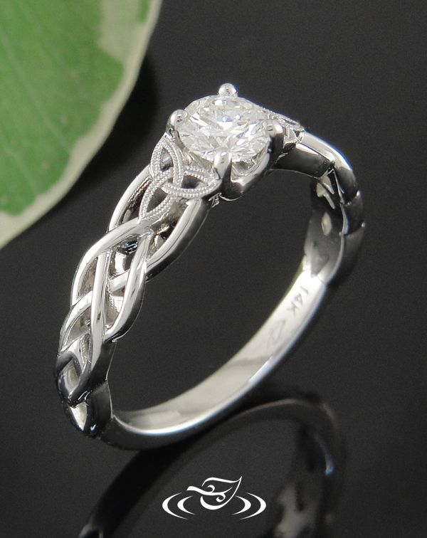 Custom 14kt X-1 white gold pierced Celtic knot style mounting with center prong set 0.44ct round brilliant diamond. Trinity knot detail on shoulders with double milgrain detail.