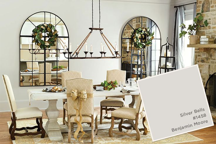wreath on mirror and ribbon/bows on chairs