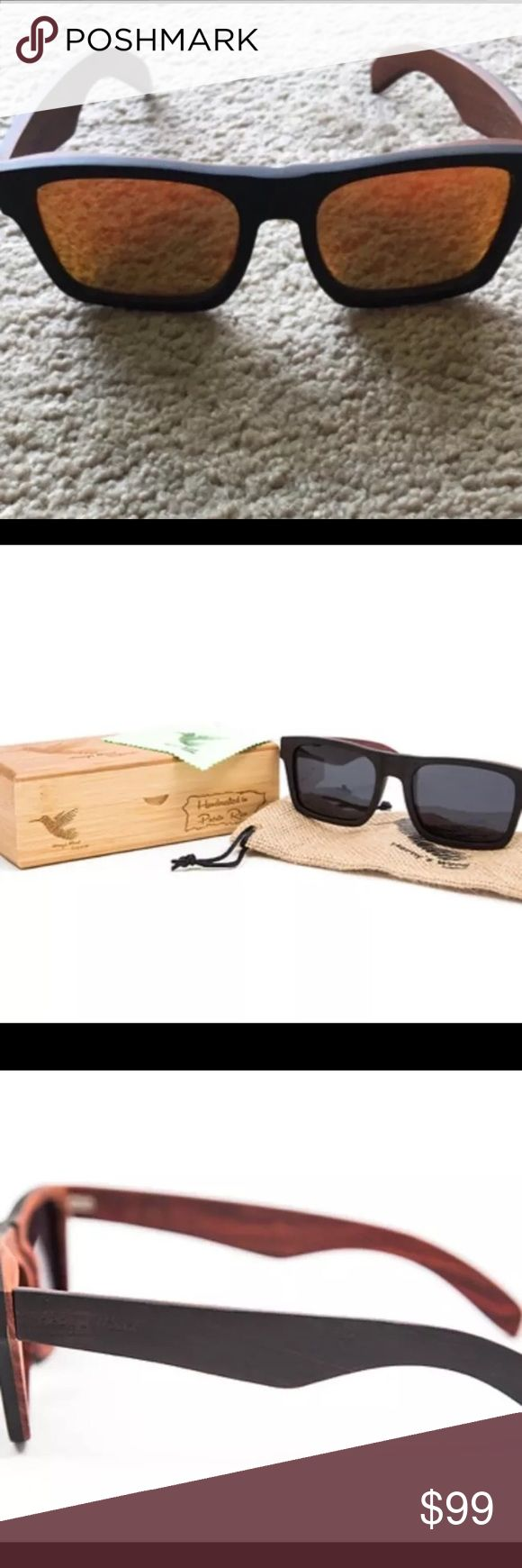 Herny's Wood Eiland Handcrafted Sunglasses Herny's Wood Sunglasses  Model - Eiland  Ebony Wood/Rose Wood Multi-Color Lens Stainless Steel Spring Loaded Hinges Hand Crafted in Puerto Rico   *These sunglasses are brand new. They are very difficult to find. If you go to their website you'll see they are sold out* Accessories Sunglasses