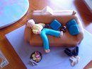 Lazy Dad Cake: This lazy Dad cake was cut out to the shape of a couch.  I put a thin layer of butter cream over the cake the added fondant.  I also did stitching on the