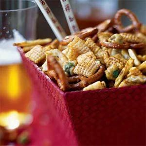 Sesame rice crackers and wasabi peas add crunch and fire to this asian party snack mix.  It's perfect as an appetizer or snack, and oh so easy to make!