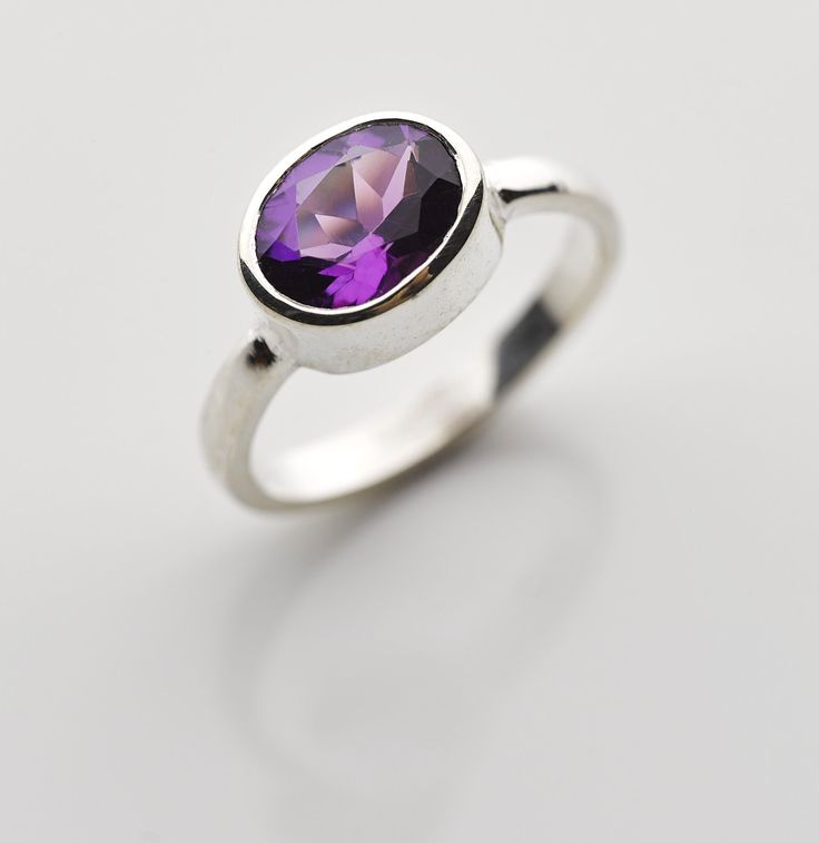 Large oval Amethyst set in a sterling silver band