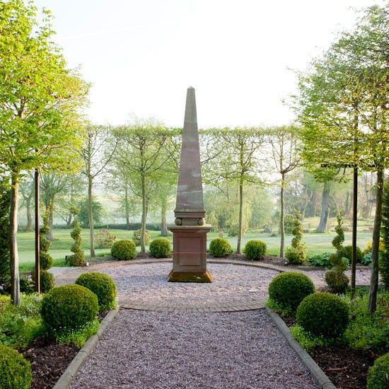 An obelisk carved out of sandstone by a local craftsman marks the end of the hornbeam avenue at the far end of the garden. Read more at http://www.housetohome.co.uk/house-tour/picture/take-a-tour-around-this-beautiful-spring-garden/2#oH3HD3X3AUEReXLe.99