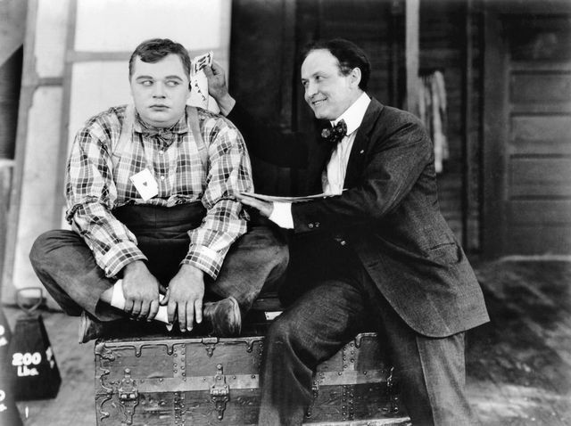 """Harry Houdini visits Roscoe Arbuckle on the set of """"Back Stage"""", 1919"""