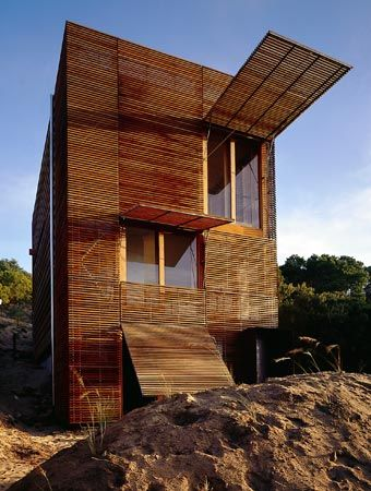 Sean Godsell. Still one of my all time favourite Australian architects. Makes these sublime, but humble, screened puzzle boxes as dwellings.
