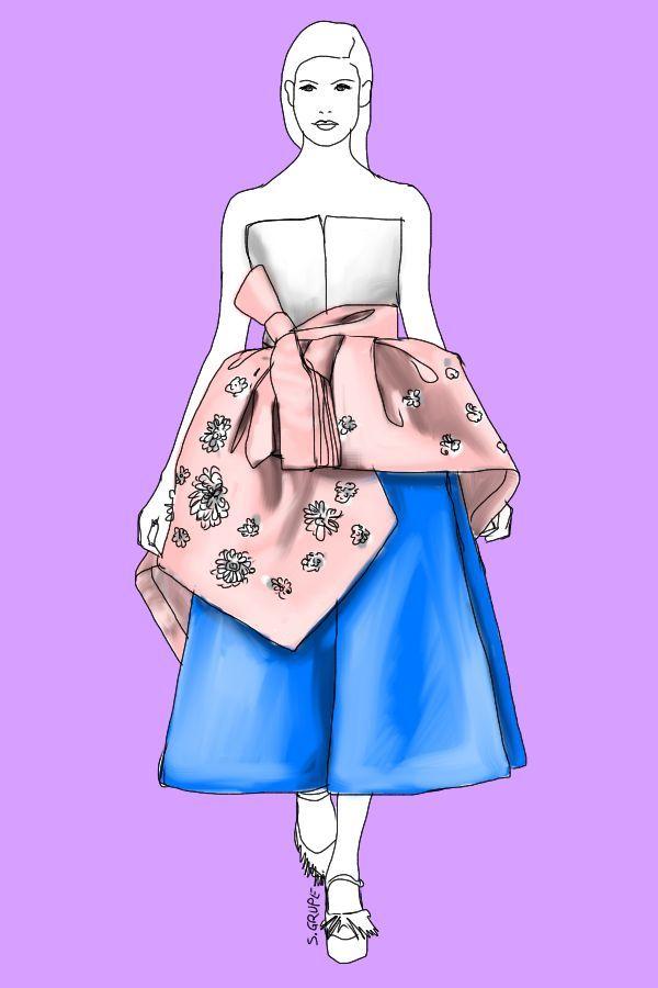 So wird Rosa erwachsen: Das rosa Schößchen mit Schleife und Blumen-Kristallen wird mit purer, geometrisch anmutender Schnittführung und klarem Knallblau gestylt.