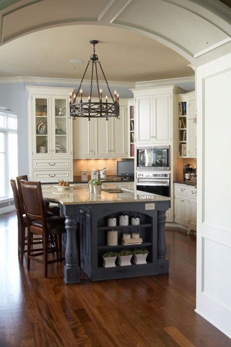 Classically beautiful white kitchen with an awesome chandelier!
