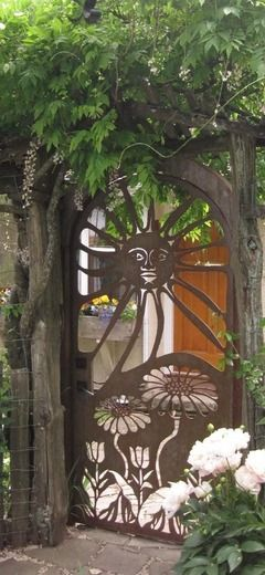 Laser-cut rustic metal garden gate on Salt Spring Island, British Columbia, Canada • photo design: Salt Spring CNC