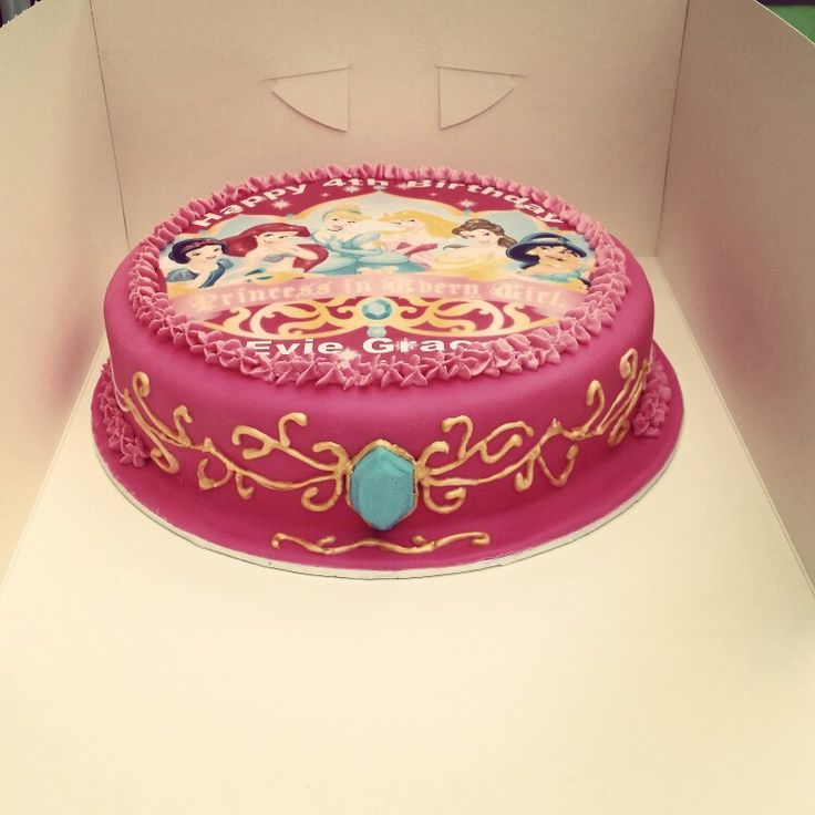 Princess cake. I piped the pattern on with royal icing then painted it gold. i made the gem from gumpaste and fondant