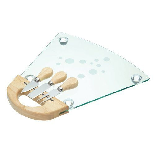 """Glass Cheese Serving Set - Board with 3 Cheese Knives by KitchenCraft. $24.99. Perfect for dinner parties and entertaining, this Master Class contemporary style cheese serving set is an elegant addition to the table. Featuring a 34cm  (Approx 13.5"""") tempered glass cheese serving board with raised supports, two cheese knives and a cheese fork, each with stainless steel blades and natural wood handles. Also features a magnetic strip for easy storage of knives whe..."""