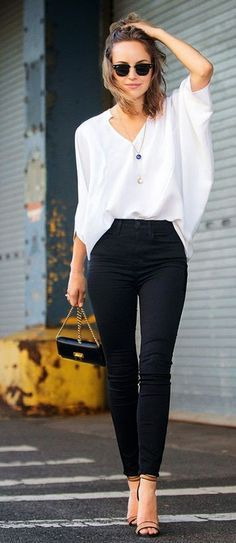 White loose blouse and high waist black skinnies.