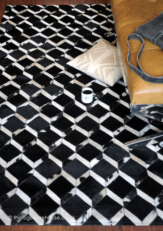 Makanza Black Rug, a stunning monochrome patterned luxury leather rug http://www.therugswarehouse.co.uk/makanza-black-rug.html … #interiors #luxuryinteriors #rugs