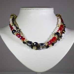 Beautiful and sophisticated multilayer necklace comprised of gold-plated chain, red Czech glass beads and a layer of white and black beads