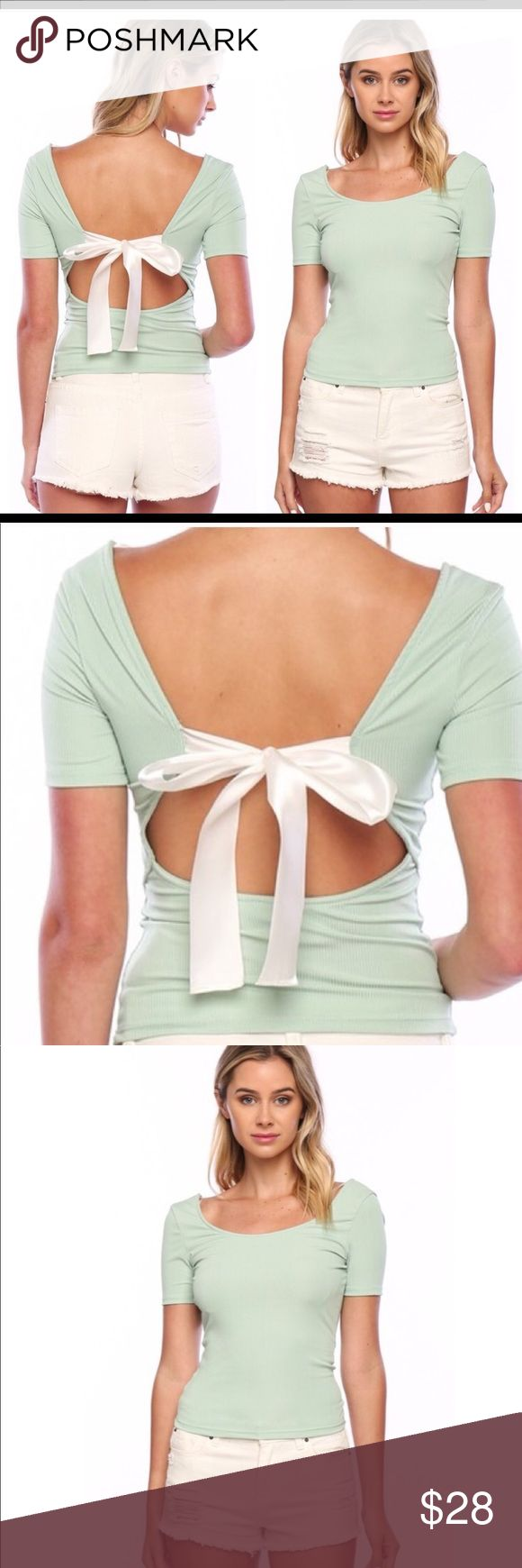 Super cute open back with Bow Top Brand new mint colored top with open back and now tie.  So cute and unique, but definitely runs small.  Have one small, one medium, and one large. Sugar Punch Couture Tops