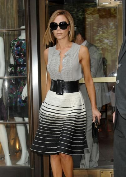Victoria Beckham. Great style. Love the sleeveless blouse, wide belt and striped skirt combo