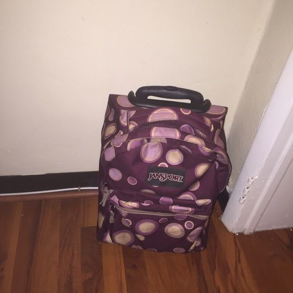 Jansport Rolling Backpack Jansport rolling backpack, eggplant color with adorable pink/purple bubble design.  Gently used and still in great condition.  Great for school or travel! Jansport Bags Backpacks