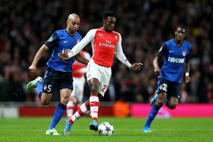 Danny Welbeck of Arsenal is pursued by Aymen Abdennour of Monaco during the UEFA Champions League round of 16, first leg match between Arsenal and Monaco at The Emirates Stadium on February 25, 2015 in London, United Kingdom.