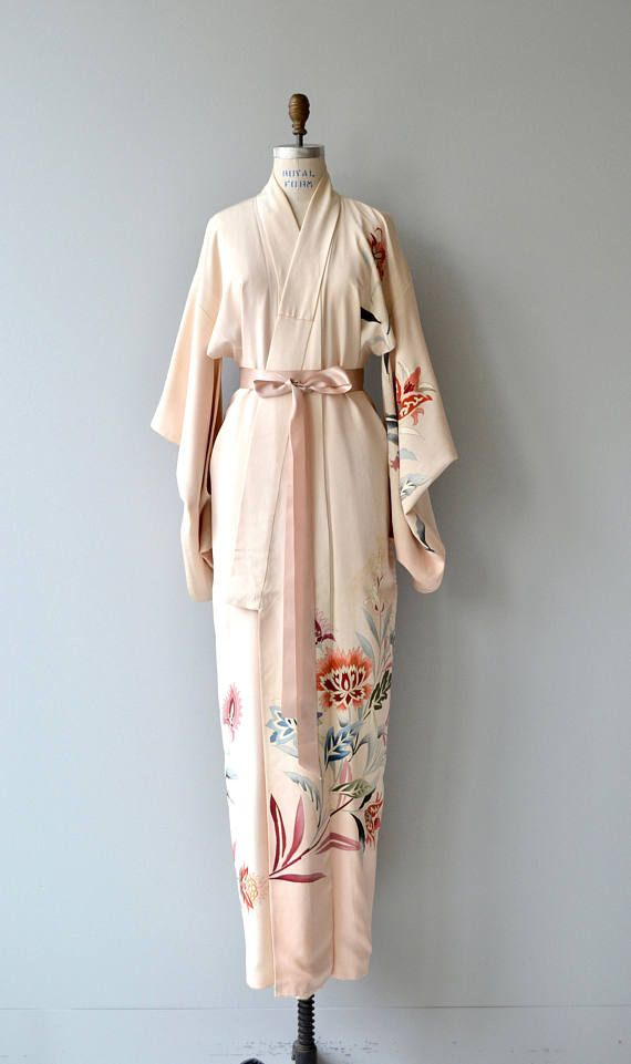 Vintage 1950s cream silk kimono with climbing vine and floral print. Great draped and weight with dusky sash. ✂-----Measurements  fits like: free size bust: free waist: free length: 61 brand/maker: n/a condition: some very slight discoloration on one sleeve and on lower portion on one side, quite minor.  ✩ layaway is available for this item  to ensure a good fit, please read the sizing guide: http://www.etsy.com/shop/DearGolden/policy  ✩ visit the shop ✩ htt...