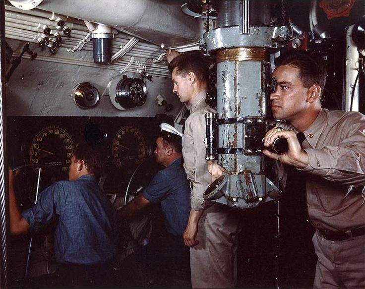 Commander of a US submarine sighting through a periscope during exercises at the Submarine Base, New London, Groton, Connecticut, United States, Aug 1943; either aboard Mackerel, Marlin, or Snook