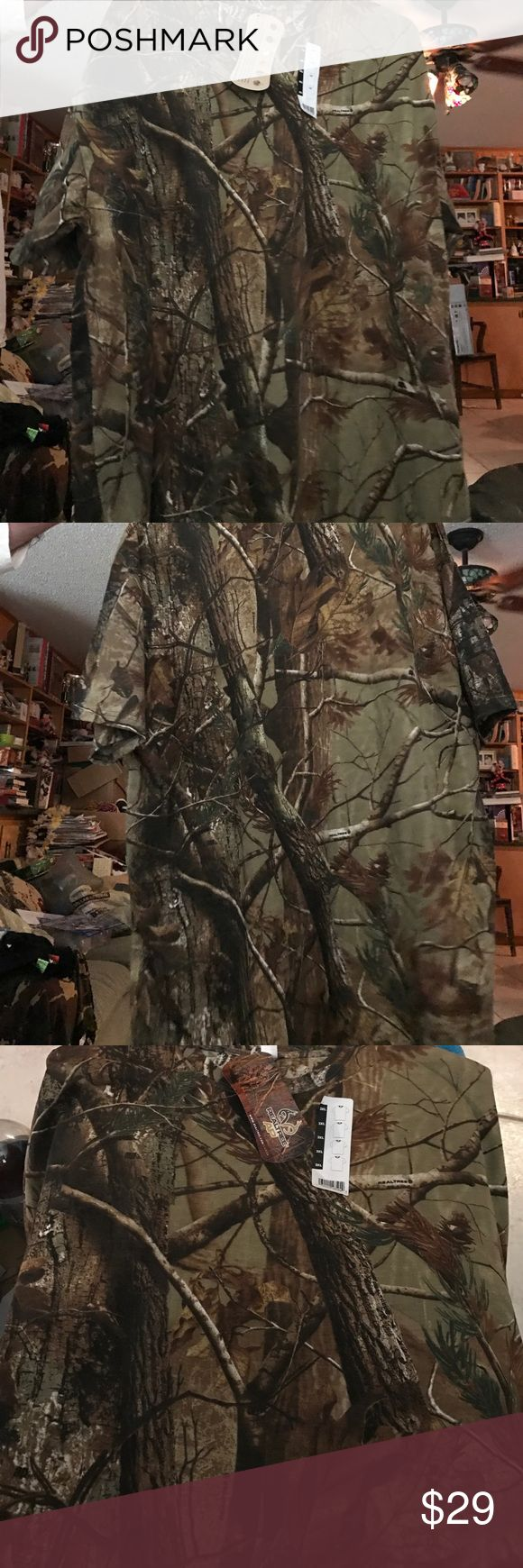Men's 3X real tree Hunter's camo T-shirt This is the famous real tree brand camo shirt. The camo is a real tree design meeting it looks like real trees look at the picture it's real trees. This is a 3XL or 3X man's shirt but would also fit a woman of a large size or if she wants to sleep in it. Great for when hunting deer. Realtree Shirts Tees - Short Sleeve