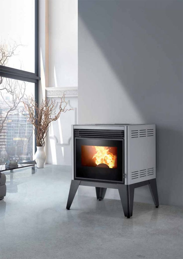 TREND: Pellet stove vs. wood burner | Ronde pellet stove, Caminetti Montegrappa  Wood burner  It has a soft bright flame, it's not powered by electricity and it's cheaper to run than pellet stoves (but it also produces less heat) Pellet stove  Pellet stoves can be automatically loaded, you can preset when it turns on and off and set your ideal temperature. You do not need a large flue and it's easier to set up, it even fits in the smallest of spaces. |