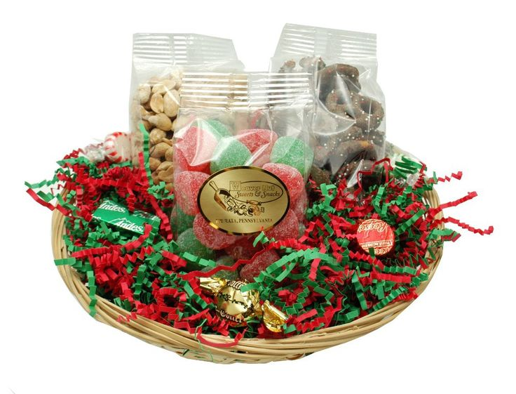 A lovely basket for anyone on your list! Consists of: Jelly Bells, Freshly Roasted & Salted Cashews, and Christmas Milk Chocolate Covered Pretzels Ribbon colors may vary. *Please note: we may substitute seasonal product items for similar products when pictured items are unavailable* 1 Round Basket of Jelly Bells, Cashews, & Choc Pretzels