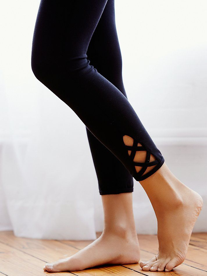 Lotus Legging | Ideal for dance, running, and all your studio workouts, these luxury performance leggings are American made from our Be Free Blend. Sleek, modern design with Picot Perfomance crisscross strapping detail along the hem.  *By FP Movement  *One of 9 exclusive, in-house labels.   *Yoga. Dance. Surf. Run. Find what moves you.