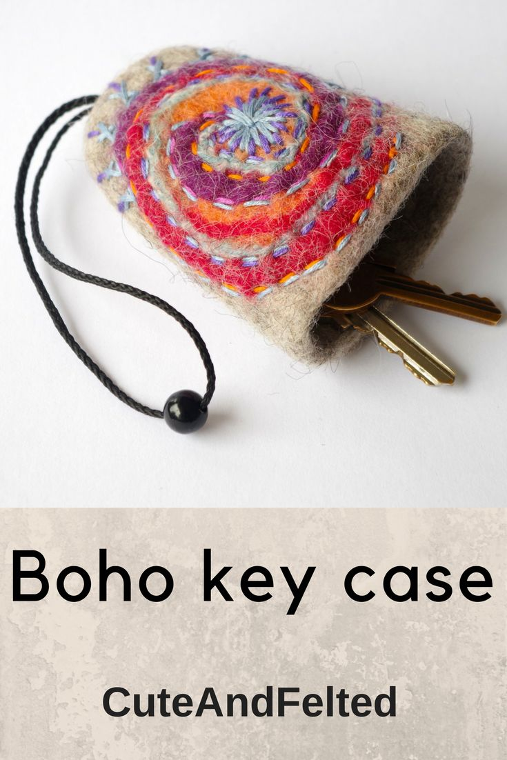 Felted and embroidered key bell with the string will protect the content of your purse from damaging with your keys. There`s enough space for 1-6 standard sized keys.