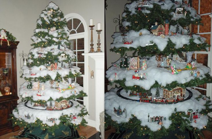 """My Village Christmas tree.  Separated and flattened branches. The bottom layer had a working train running around it.   Each section had one or more """"villages"""" in it - Wizard of Oz - complete with tornado, Candyland, Farmville/Hay Day, Lighthouse w ship - etc.  See here on HGTV Share My Craft for more pics: http://my.hgtv.com/share-my-craft/Holiday/Village-Christmas-Tree/detail.esi?oid=2399194"""