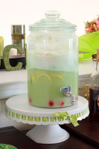 2 Quarts Lime Sherbet  2 Liters Ginger Ale  36oz of Pineapple Juice (I used six 6oz cans)  Sliced Lemons and Limes  Maraschino Cherries