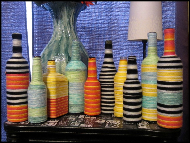 Yarn-wrapped bottles! Recycled liquor, wine, beer, & soda bottles. Party centerpieces or home decor for less than 10 dollars. Simply use mod-podge and your favorite colors of yarn!
