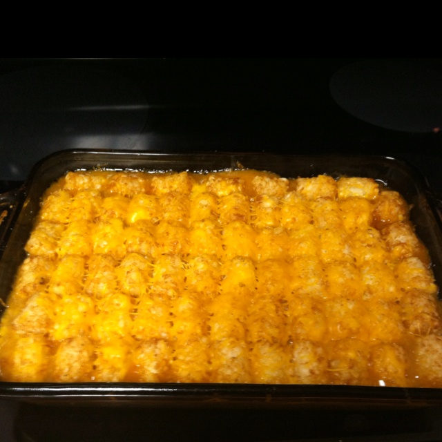 Taco Tater Tot Casserole  So easy and very yummy  1 lb. hamburger 1 pkg. taco mix 1/4 c. milk 1 can cream of chicken soup Cheese Brown and drain hamburger. Prepare taco mix according to packet. Spread mixture over casserole dish. Heat cream of chicken soup with 1/4 cup of milk. Pour over hamburger mixture. Lay slices of cheese on top. Line tater tots on top of cheese and bake for 30 minutes or until brown.