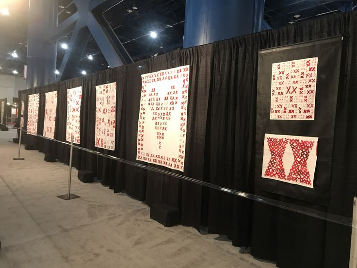 One wall of The 70273 Project quilts on display in the Special Exhibit at International Quilt Festival 2017