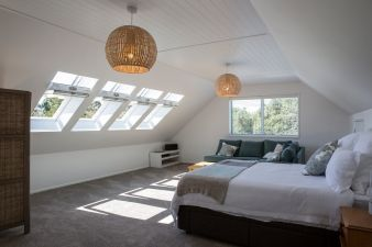 Master bedroom with leafy views and ample sunlight