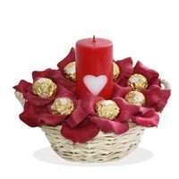 A perfect ultra romantic gift to charm someone with life's little pleasures, sweet treats of chocolates, and see how it adds spark and life to an otherwise normal day. 16 Pieces Ferrero Rocher chocolates in a basket with one Pillar Candle.  http://www.fnp.com/flowers/christmas/christmas-gift-hampers/charming-celebration/--clI_2-cI_1938-pI_17997-pCI_1148-i_17997.html