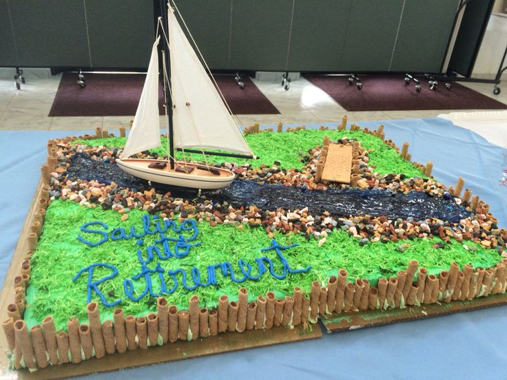 """Retirement cake with a nautical theme. Cake border is various sizes Pirouette cookies. Chocolate """"rocks"""" are at the banks of the colored gel icing river. Dyed coconut was added for grass. A graham cracker pier juts out as the boat sails in. All of this was prepared on two full sheet cakes from BJ's. They graciously iced them plain and airbrushed then green."""