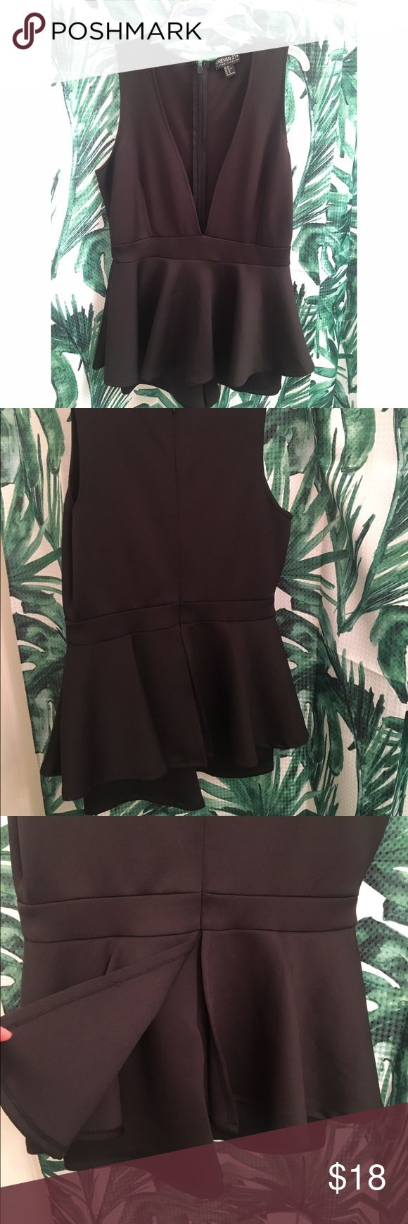 Forever 21 black peplum romper OX Super cute black peplum romper with plunging neckline, had peplum skirt with shorts that show underneath. Size 0x which I think like XXL , never been worn Forever 21 Dresses Mini