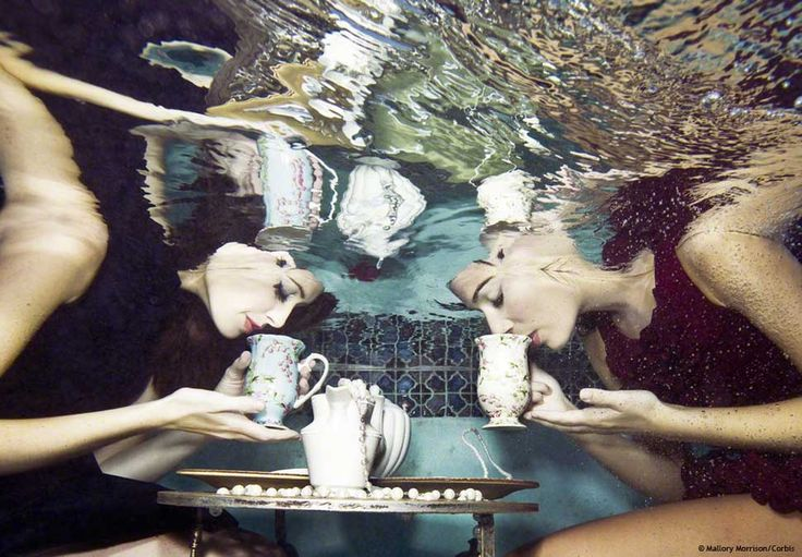 Young women having tea under water, surreal underwater photography by mallory morrison