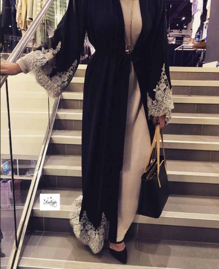 A beautiful black open abaya with with grey/white lace at the bottom and at the…